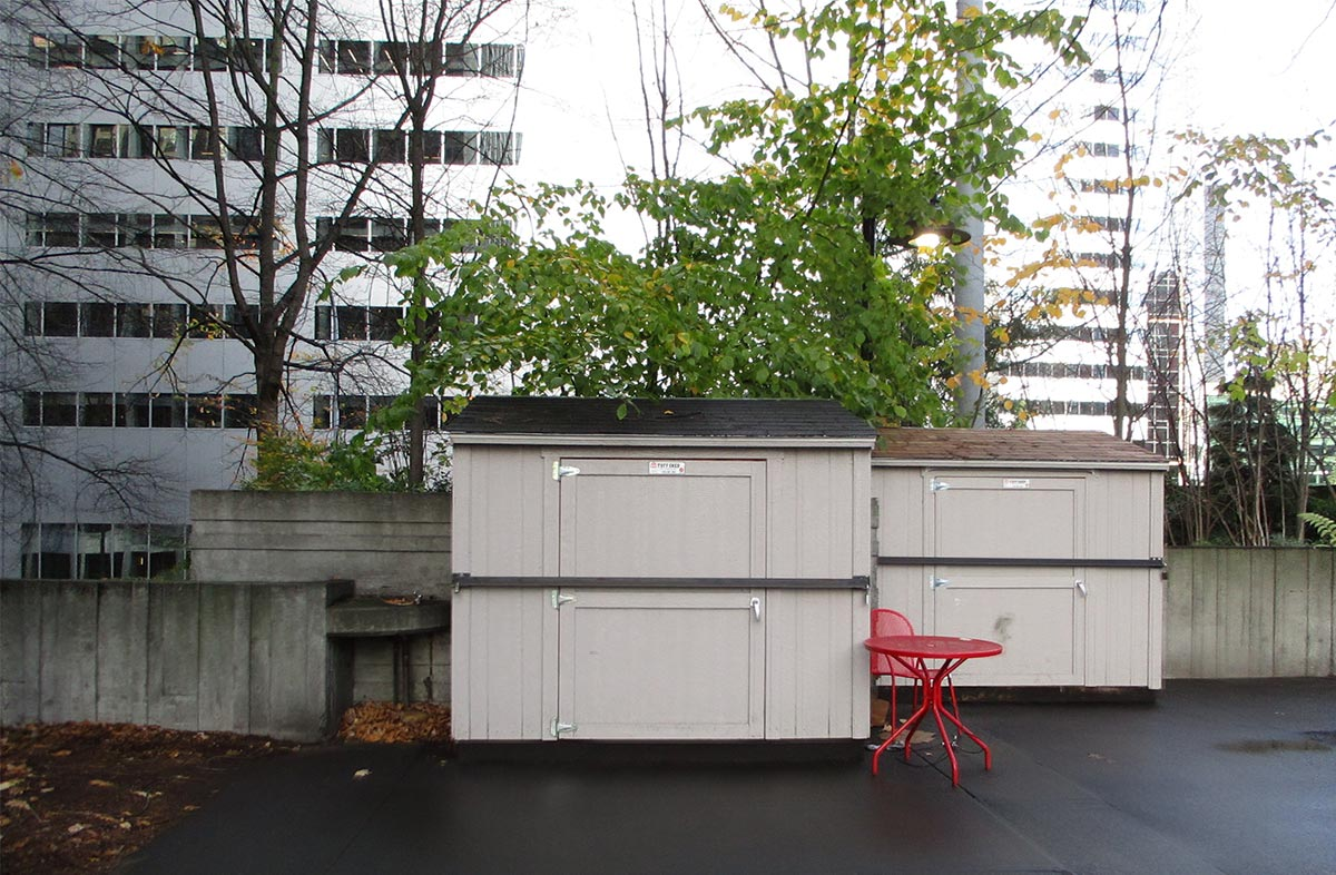 Image of storage sheds at Freeway Park showing how site conditions require restoration and repair.